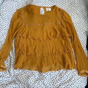 Mustard ruffled blouse from French designer Sézane